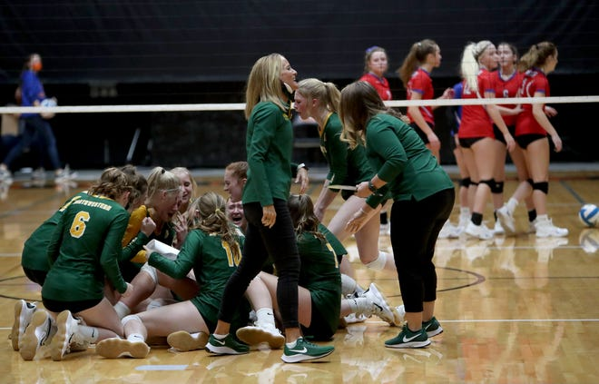 Northwestern volleyball coach Nora Groft, center, smiles as her players celebrate on the floor after winning the Class B championship by defeating Warner 3-1 Saturday night in Huron. American News photo by John Davis taken 11/21/2020