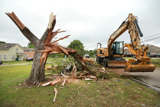 Tupelo Public Works employees work to remove additional tree debris and limbs on Monday, May 3, 2021, after a tornado struck the area last Sunday night in Tupelo, Miss. (Adam Robison / The Northeast Mississippi Daily Journal via AP)
