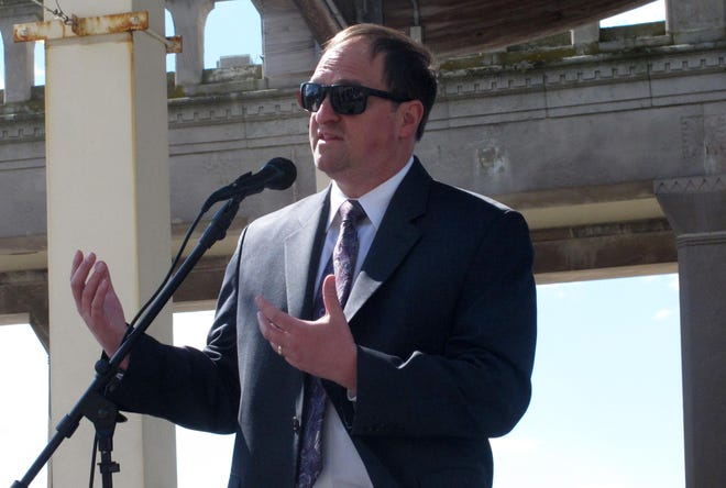 Michael Chait, president of the Greater Atlantic City Chamber of Commerce, speaks at a news conference on the Atlantic City Boardwalk on Friday. Chait and other business and political officials called on Gov. Phil Murphy to ease coronavirus restrictions enough to allow conventions and trade shows to resume.