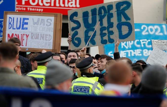 Chelsea fans protest against Chelsea's decision to be included amongst the clubs attempting to form a new European Super League before the English Premier League soccer match between Chelsea and Brighton and Hove Albion outside Stamford Bridge stadium in London on Tuesday.