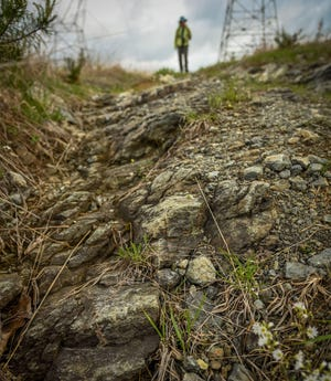 Exposed mantle rock is seen along a power line access road in Soldiers Delight. (Jerry Jackson/Baltimore Sun/TNS)