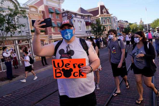 Guests walk down Disneyland's Main Street USA for the first time in over a year April 30 in Anaheim, Calif.