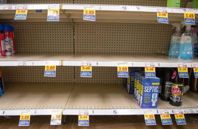 TOP RIGHT: Cleaning products including sanitary wipes had been mostly bought out Friday at the Kroger just south of Bloomington. (Rich Janzaruk / Herald-Times)