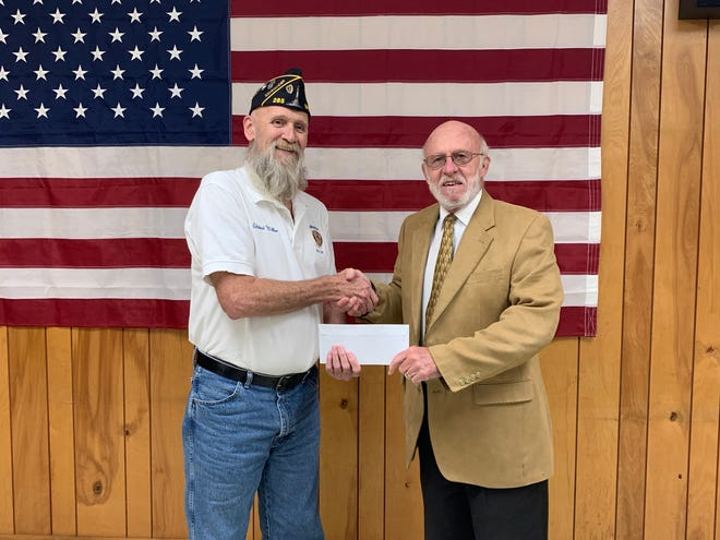 American Legion Post 285 donated $1000 to the Spencer Exchange Club for the Bikes for Tykes program. Pictured is Commander LD Miller with John Fuhs accepting on behalf of Bikes for Tykes. (Submitted / Spencer Evening World)
