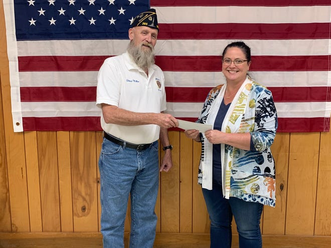 American Legion Commander LD Miller is shown presenting a check for $1,000 to Jennifer Abrell, 4-H Educator. This money has been donated to the 4-H Fishing Team. (Submitted / Spencer Evening World)