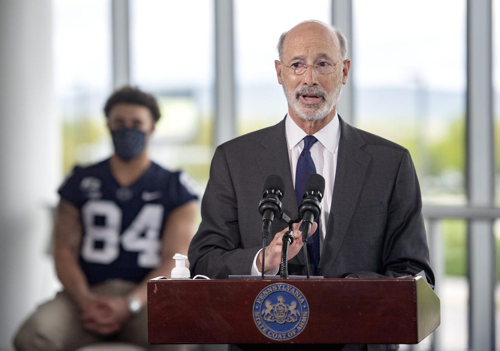 Pennsylvania Gov. Tom Wolf speaks about the importance of getting a COVID-19 vaccine during a visit to Penn State's Pegula Ice Arena.