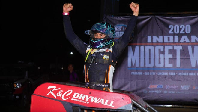 Kyle Larson celebrates his 2020 Indiana Midget Week victory at Paragon Speedway Tuesday night. It was Larson's 8th consecutive win in USAC Midget competition. (Courtesy photo / USAC Racing)