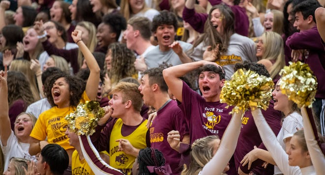 Bloomington North fans cheer during the January 2020 meeting boys' basketball game between the Cougars and Bloomington South. North's athletic department lost a great deal of income when this year's meeting was canceled. South will play host to this season's game.