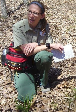 Jill Vance, interpretive naturalist, interacts with a hiker during one of the many programs she hosts. (Courtesy photo)