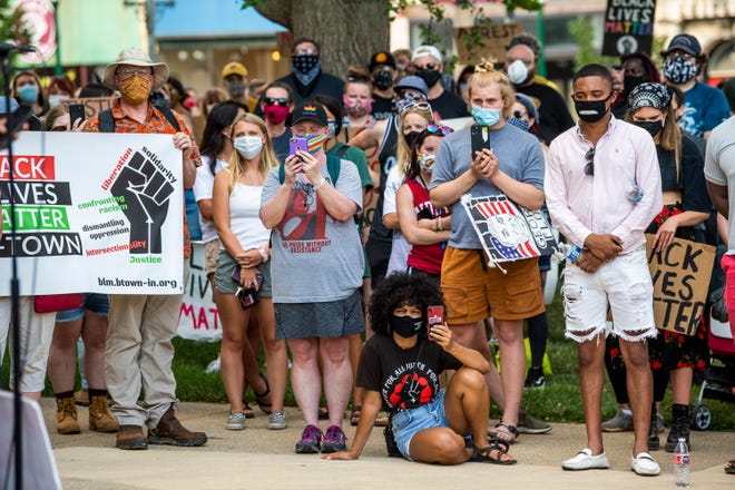 Demonstrators listen to speakers on the evening of July 6, 2020, during a peaceful protest for racial justice at the Monroe County Courthouse.