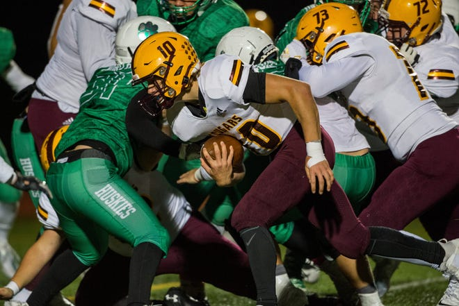 Bloomington North's Cody Mikulich (10) scores a touchdown as brothers Marcus Wynalda (73) and Max Wynalda (72) wall off a running lane against Evansville North in their Class 5A Sectional 15 semifinal game last year.