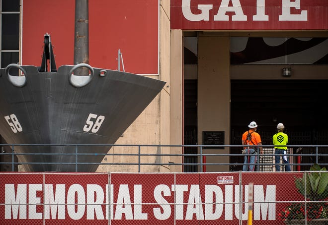 Construction crew employees look over Indiana University's Memorial Stadium as they continue with upkeep improvements on Tuesday. (Rich Janzaruk / Herald-Times)