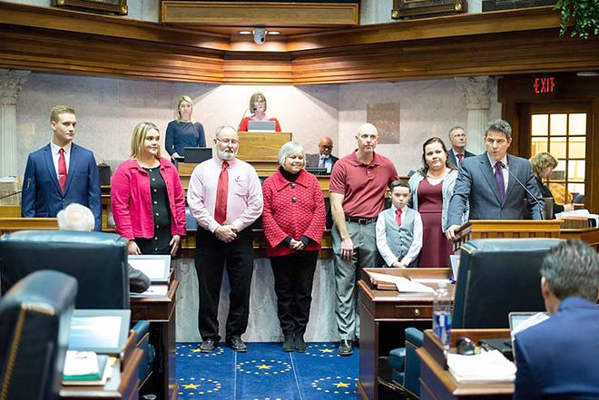 Senate President Pro Tem Rodric Bray (R-Martinsville, podium) presentesd the Badger family, owners of the Martinsville Candy Kitchen, with Senate Resolution 16 in the Senate Chamber on Tuesday, Feb. 18. SR 16 honors the store's 100 years in business. A community staple since 1919, the world-renown Martinsville Candy Kitchen is one of only a few remaining candy stores that still makes candy canes by hand. The local small business has made up to 40,100 candy canes in one year and ships worldwide. (Submitted photo)