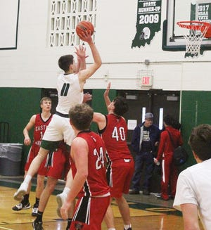 Josh Smith, Monrovia's 6-8 senior center, floats above Eastern Greene defenders as he hits one of his nine field goals in Friday's Monrovia Holiday Classic semifinal game. (Steve Page / Correspondent)