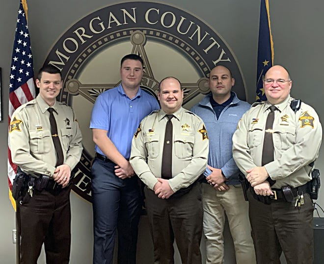 Pictured are, from left, Lt. Jacob Babbs, Joshua Bertelsen, Major David Rogers, Donald Lane, Lt. Eric Mullikin. (Morgan County Sheriff's Office photo)
