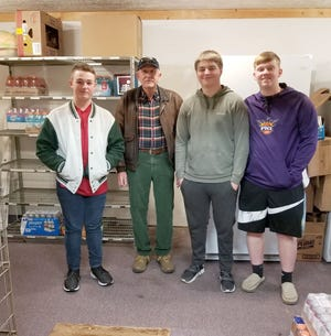 Coach Don Pearson and members of the Monrovia boys golf team worked at the Gasburg Baptist Church food pantry on Tuesday, Feb. 11. Coach Pearson and the golf team wanted to find a way to help give back to our community members that were in need. When talking about a necessity in life such as food, giving back can mean so much. Coach Don Pearson, Titus Boswell, Brock Russell and Jonah Freeman all helped to serve community members. (Submitted photo)