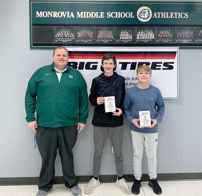 Drew Elmore and Parker Hale of the Monrovia Middle School wrestling team have been named as the Big O Tires Athletes of the Week. Eighth-grader Drew Elmore continues to push himself and his teammates during practices. His hard work and dedication continues to show on the mat, as he was able to defeat Lutheran in a tough match (3-2). Seventh-grader Parker Hale missed most of the beginning of the season due to an injury, but was able to return to the mat for the first time this week and secure his first victory of the season. Parker's win helped the Bulldogs get the win (60-30) over the Lutheran Saints. Presenting the award is Monrovia High School Athletic Director Todd Evers. (Submitted photo)