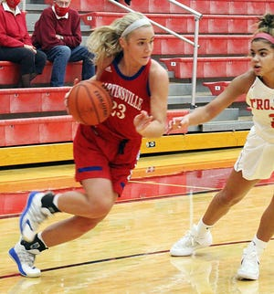 Martinsville junior Delaney Wolfe drives the baseline against Center Grove defender Aubrie Booker during a game in December. Wolfe scored 15 points in the win over Whiteland. (Steve Page / Correspondent)