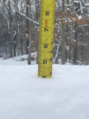 RIGHT: Owen County received another round of winter precipitation Monday night with unofficial local amounts anywhere from 3-5 inches. Just outside of Spencer, four inches of snow was measured. (Amanda York / Spencer Evening World)
