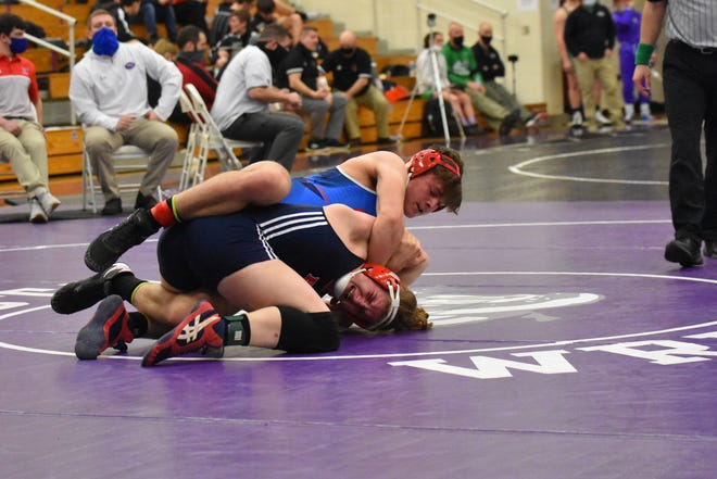 ABOVE: Competing in the 195 weight class, OV sophomore Eli Hinshaw sets his opponent up for the pin, getting the arm hook. (Amanda York / Spencer Evening World)