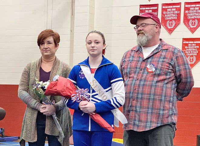 Lady Patriot senior Madison Teague is shown with her parents, Amanda and James Teague. Madison is a four-year varsity gymnast. Her future plans are to attend either Indiana University or Trine University to major in education. (Submitted / Spencer Evening World)