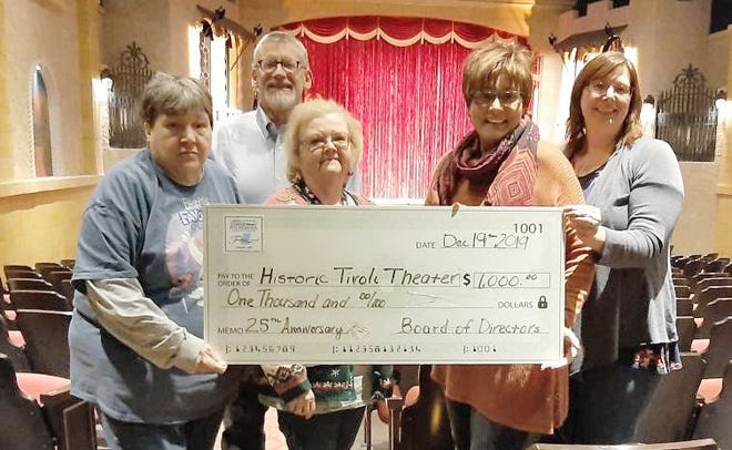 The Owen County Community Foundation wrapped up the year by finishing up their special 25th Anniversary grants with two presentations to the Historic Tivoli Theater and the Gosport Volunteer Fire Department. Accepting the grant issued to the Historic Tivoli Theater are, left to right: Tivoli volunteers Susie Terrell and Sharron Barger, Marketing Director Jane Rubeck, and Tivoli Director Andrea White. In the second feature, the Gosport Volunteer Fire Department accepted the grant with members Kemper Freeman, Joann Stirewalt, and Juston Tackett in front; Donnie Hall, Erik Norman, Hezekiah Pleake, and Tony Minnick in the middle; and Mark Williams, Robert Hawkins, and Brandon Baker in the back. Representing your OCCF was President / CEO, Mark Rogers, and Donor Relations Manager, Karah Bobeck. We are incredibly thankful to all of the Owen County organizations that were able to participate in our 25th Anniversary grant presentations and we look forward to 25 more years of working with the community. (Submitted / Spencer Evening World