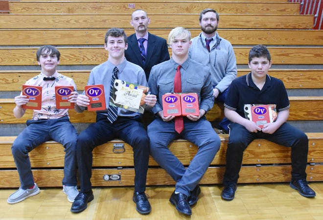 LEFT: The OVMS wrestling team has had great success this season so far, including 223 takedowns and 137 pins. Award winners at Monday night's winter sports banquet include, front row, from left: Branson Weaver (Most Pins — 17 and Most Takedowns — 34); Cale Nickless (MVP); Issiah Wittman (Best GPA, Mental Attitude); and Dylan Hale (Most Improved). Back row: Coaches Matt Riddle and Casey Bybee. (Amanda York / Spencer Evening World)