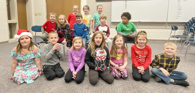 Kindergarten, first and second grade winners for December are, front row: Brooklyn Fletcher, Ayden Holland, Maddie Sparks, Makayla James, Mia Owen, CJ Wood and Kaiden Abbot. Second row: Eric McFarland, Autumn Henry, Jaren Neibel, William Baker and Deondra Parker. Back row: Aubriana Burke and Megan Mobley. (Submitted / Spencer Evening World)