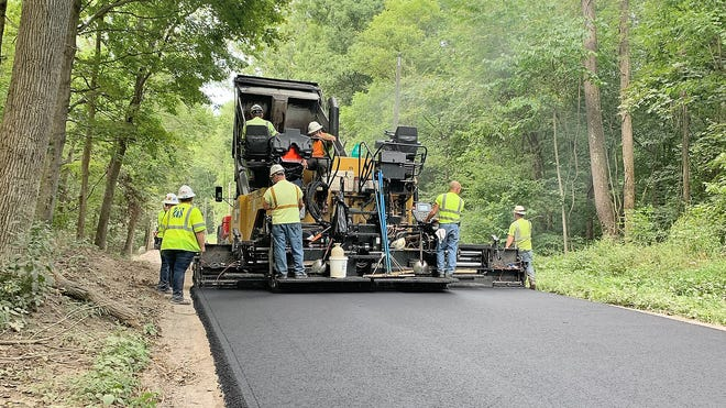 Crews from Milestone were on hand Monday morning, laying asphalt on Childers Road in northern Owen County. This paving was the first of the season to be lead via the Community Crossing grant of 2020. The work, weather permitting, was set to be completed Tuesday with paving crews moving to Denmark Road in western Owen County for the next job. (Submitted / Spencer Evening World)
