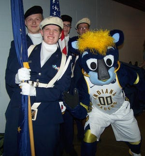 The Owen Valley Junior Air Force ROTC, under the direction of Alfred Johnson, SSGT, USAF-Retired, attended the Indiana Pacers game on Thursday, Jan. 29, presenting the colors before the game. This game, vs. the Chicago Bulls, marked the return of beloved former Indiana University standout Victor Oladipo. JROTC members are shown with Pacers' mascot Boomer and as they took the floor during the game. (Submitted / Spencer Evening World)
