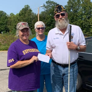 Just in time for the holidays, the Spencer American Legion recently made a donation to area food pantries, giving $1000 dollars to each entity to help combat hunger this holiday season. American Legion Commander LD Miller presents a check to Garrard Chapel Food Pantry volunteer Monica Barger. (Submitted / Spencer Evening World)