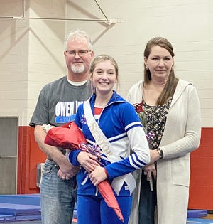 Owen Valley gymnastics senior Peyton Loughead is shown with her parents, Jamie and Jeanine Loughead. Peyton is a four-year varsity gymnast. Her future plans are to complete a biology major at Indiana State University and then attend Purdue's School of Veterinary Medicine. (Submitted / Spencer Evening World)