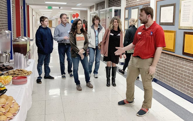 LEFT: Patriot Manufacturing Production Manager Zach Crowe is pictured leading a group of visitors on a tour of Patriot Manufacturing and the OVHS Spirit Shop. (Submitted / Spencer Evening World)