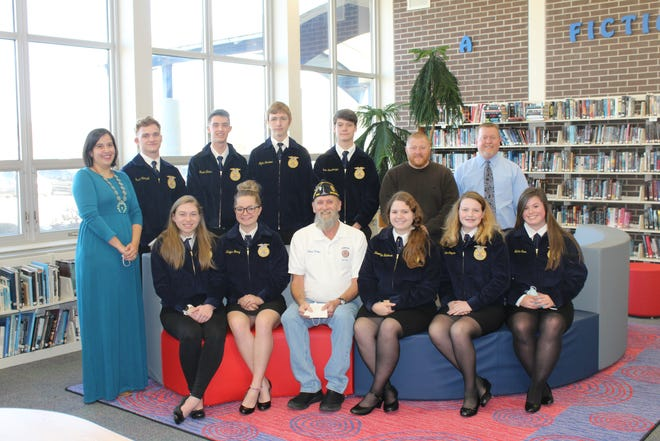 Included in the presentation were, from row, from left: Norah Beeman, Kalynn Nanny, Eldred Miller, Brooklyn Henderson, Kailee Cooper and Hailey Amick. Back row: Shelby Wolford, Charlie Campbell, Mason Elkins, Myles Gardner, Brock Rosenberger, OVHS Principal Robert Boltinghouse, and Superintendent Dr. Chad Briggs. (Courtesy Photo)