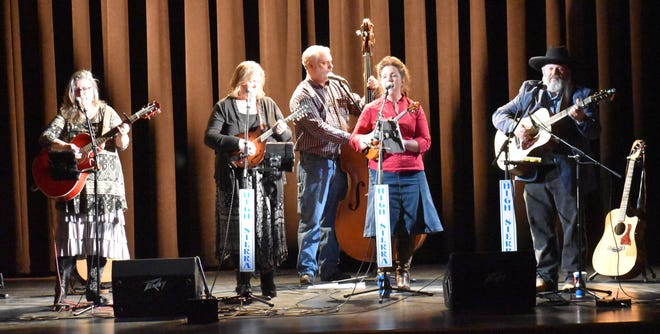 Saturday afternoon, the Tivoli Theatre was alive with the musical melodies of High Sierra, with a near-full house audience of folks tapping toes and clapping hands to the sounds of gospel, bluegrass, country and folk. The Spencer Evening World sponsored the event. Band members include, from left: Tammy Pate, of Spencer, on vocals & acoustic guitar; Pam Waterford, of Whitehall, on vocals, mandolin and guitar; Mark Spriggs, of Owensburg, on vocals and upright bass; Mindy Bounds on vocals and fiddle; and Tim Adams, of Whitehall, on vocals, acoustic guitar, banjo and mandolin. Missed this performance? Join them at their next performance at the Gosport Christian Church at 6 p.m. on Saturday, February 22. Free admission. Come early for the chili and potato soup dinner at 4 p.m. or Sunday, April 19 at the Western Gospel Concert at Mansions in Heaven, in Bloomfield. (Casey Shively / Spencer Evening World)