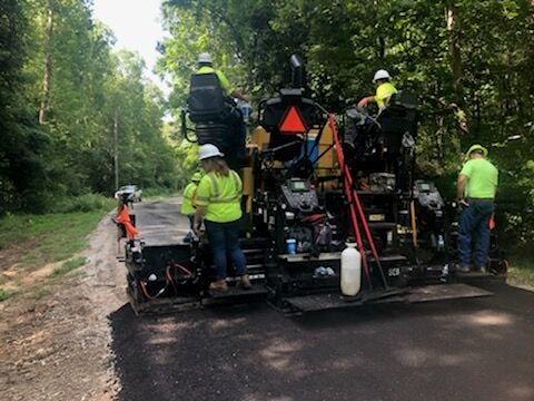 Akron will be continuing with its 2021 road resurfacing project. Here, a crew works on a road project in this file photo.