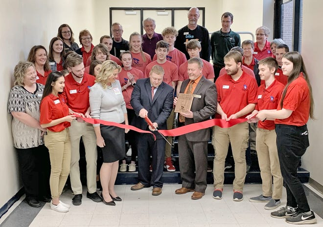 LEFT: OVHS Principal Robert Boltinghouse is pictured with Owen County Chamber of Commerce Executive Director Marce King and Superintendent Chad Briggs cutting the ribbon to officially open Patriot Manufacturing. (Submitted / Spencer Evening World)