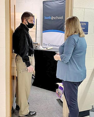 RIGHT: OCB Branch Manager Jennifer Knapp is pictured above giving a quick tour of the OVHS Financial Literacy Academy to Crane Credit Union Vice President of Operations Ryan Lee. (Submitted / Spencer Evening World)