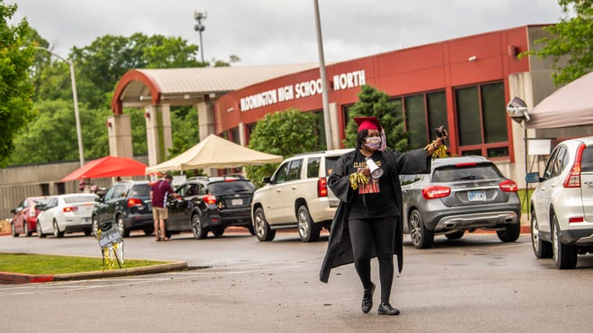 JaQuita Joy Roberts welcomes students and parents to equipment dropoff and diploma pickup at Bloomington High School North on Thursday. (Rich Janzaruk / Herald-Times)