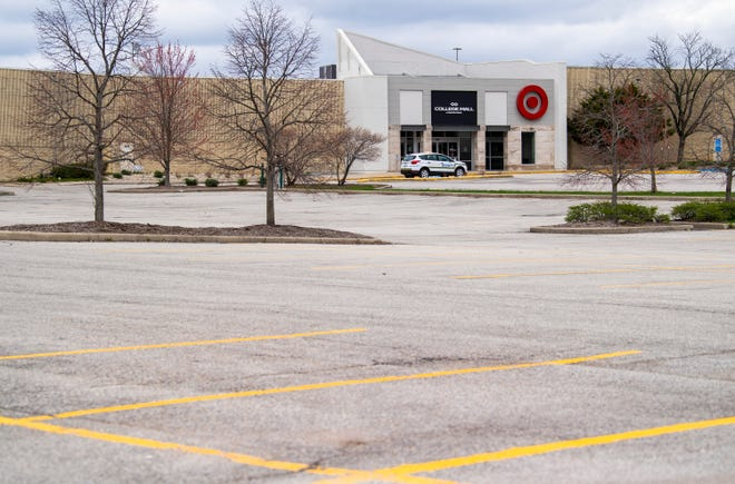 A Simon Security SUV drives through an empty College Mall parking lot April 1 on Bloomington's east side. The mall reopened May 16, and is now able to allow 75% capacity. (Rich Janzaruk / Herald-Times)