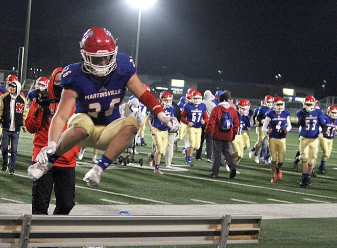 Martinsville junior Westyn Pemberton (26) leads his team to the bleachers for the school song after Friday's IHSAA Sectional win over Greenwood. (Melissa Dillon / Correspondent)
