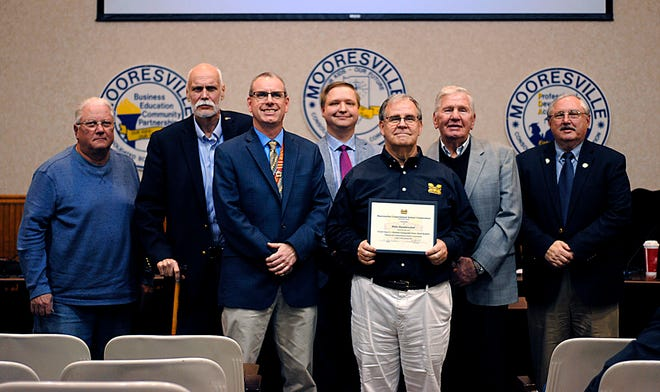 The Mooresville School Board members pose for a photo with high school athletic director Mike Mossbrucker in January. The board was recently recognized as commendable by the Indiana School Boards Association. (File photo)