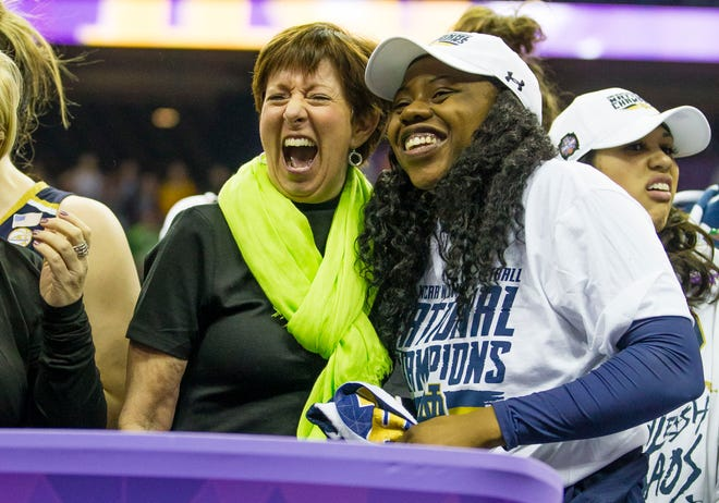 Notre Dame head coach Muffet McGraw and Arike Ogunbowale celebrate after winning the national championship in 2018.