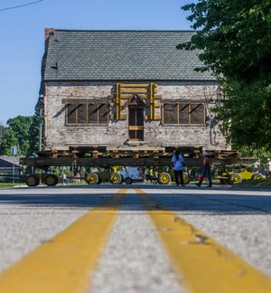 A crew works to move a historical home from it's original site to a location about four blocks to the west on Napoleon Street on Thursday, Aug. 20, 2020, in South Bend.