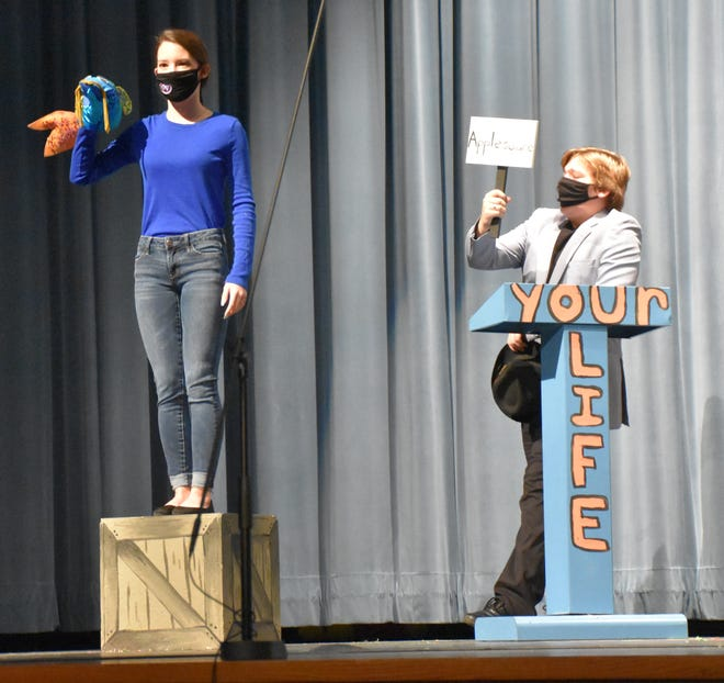 The Talking Fish (Lexi Pinkard) and the Gameshow Host (Lucas Abrell) take the stage. (Amanda York / Spencer Evening World)