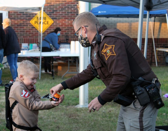 The little 'Ghost Buster' was visibly excited as he received a special treat from OCSD Deputy and School Resource Officer Daniel 'Opie' Rheinhart. (Nicole DeCriscio / Spencer Evening World)