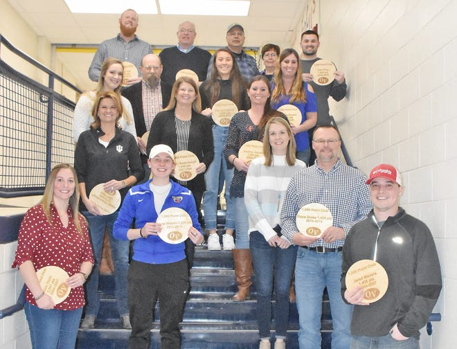 In February 2020, Owen Valley High School welcomed back and recognized former and current athletes that scored 1,000 points or more during their basketball careers. A new sign that hangs in the gymnasium with the names and point totals, was donated by Rob Ranard and Sam Carver with The Home Team Properties. Each member was presented with wooden plaque commemorating their accomplishment. Athletes include, front row: Jared Maners (1,400 points and 2006 sectional champs, class of 2007). Second row, from left: Sam Stahl (2,057 points and two-time sectional champ, class of 2007); Alicia Wilson (1,229 points and 2014 sectional champ, class of 2014); and David and Brozia Drake, representing Dazia Drake (1,438 points, 2018 sectional champ and class of 2019). Third row: Karen Redenbaugh (1,733 points, class of 1990); Darci (Redenbaugh) Martin (1,940 points, 3-time sectional champ and class of 1994); and Heather Gonser (1,393 points, member of the 2008-2009 state finalist team, class of 2009). Fourth row: Kaitlin (Sweatman) Abrell (1,048 points, member of the 2008-2009 state finalist team, class of 2010); Steve Stanger (1,268 points, 1971 sectional champ, class of 1973); Payton Cattorini (1,053 points, 2018 sectional champ, class of 2018); and Nickole Gonser (1,088 points, member of the 2008-2009 state finalist team, class of 2009). Back row: Cody Vest (1,019 points, class of 2015); Greg Wright (1,699 points and 1985 sectional champ, class of 1985);Mike and Nancy Huthinson on behalf of David Hutchinson (1,042 points, class of 1995); and Cam King (1,009, class of 2015). Not pictured: DeVonne Mullis (1,166 points and three-times sectional champ, class of 1994). The newest member of the group, with 1,000 points and counting, was 2019-2020 OVHS junior Stephen Atkinson (not pictured). (Amanda York / Spencer Evening World)