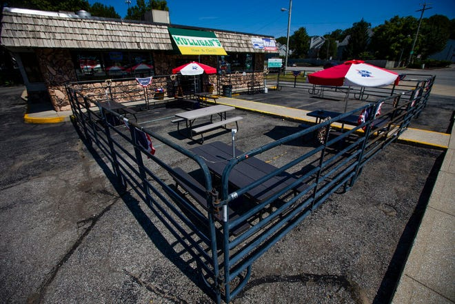 Mulligan's Bar and Grill has a large outdoor patio in South Bend. Owner Pat Mulligan said customers can hear the band at Notre Dame Stadium from the parking lot.