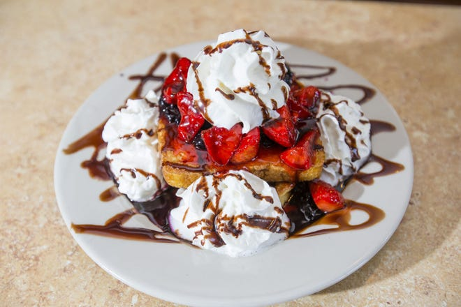 The stuffed French toast at Lux Cafe in Goshen contains cream cheese between two slices of French toast and is topped with strawberries, blueberries and chocolate.
