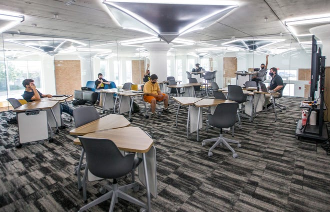 Students and employees wear masks and sit at a distance during the first day of classes at Purdue Polytechnic High School on Aug. 12, 2020, in South Bend. Students entering the classrooms in Michiana this fall face differing policies with masks.